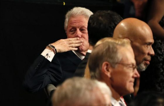 Former U.S. president Bill Clinton throws a kiss to someone in the crowd. REUTERS/Rick Wilking